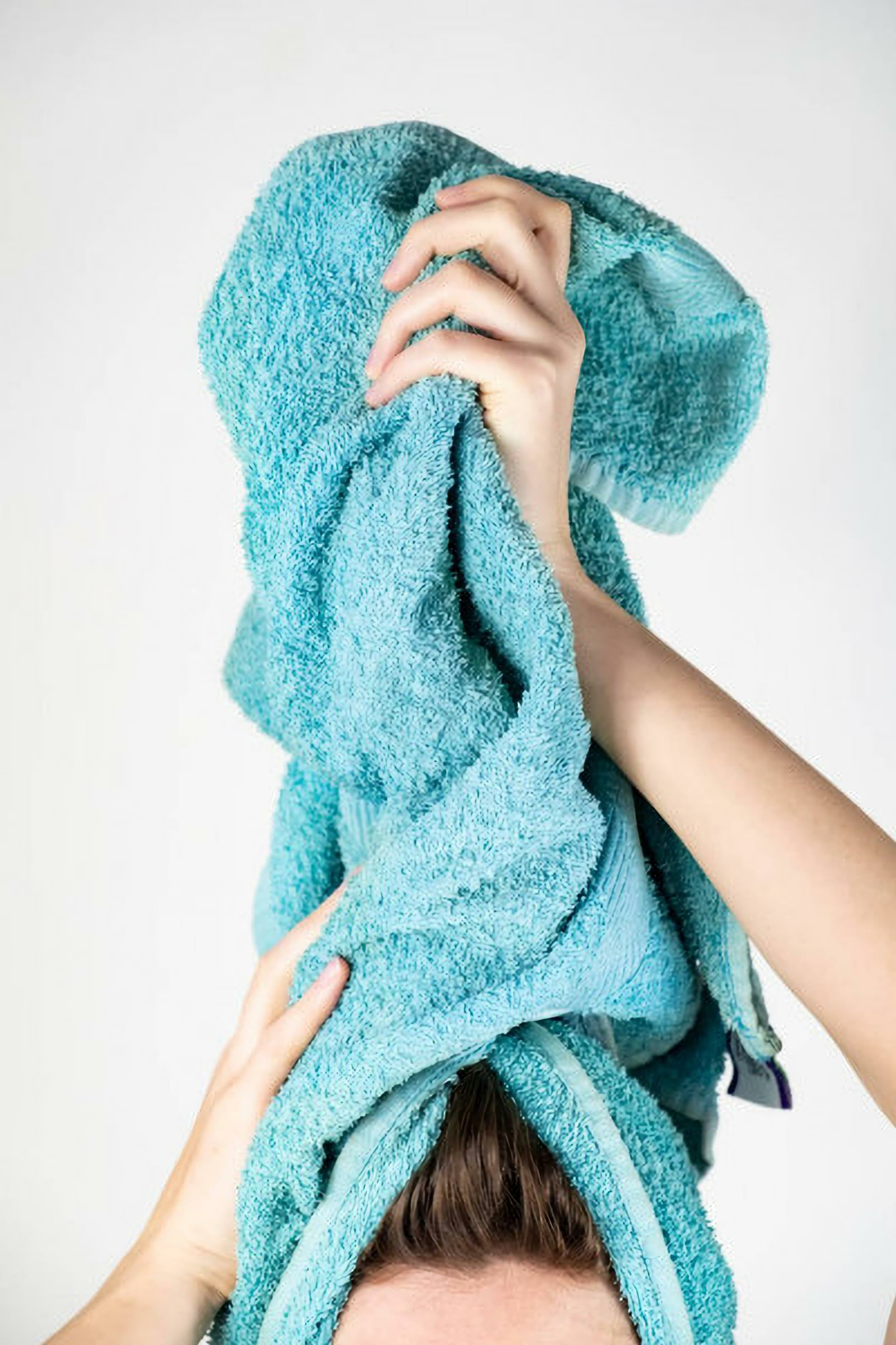 depositphotos_248873540-stock-photo-female-drying-her-hair-withResized-opt